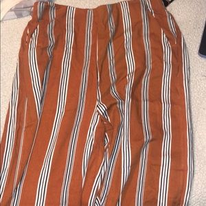 Flowy orange pants with white and black stripes